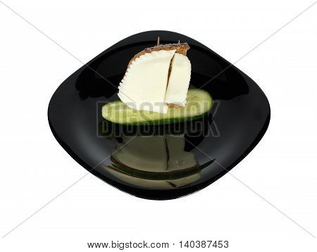 Decoration of food. Sailing ship from cheese cucumber and bread on a plate of black color. Isolation on a white background