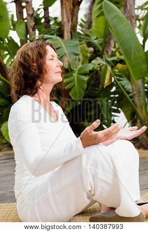 Full length of woman doing yoga