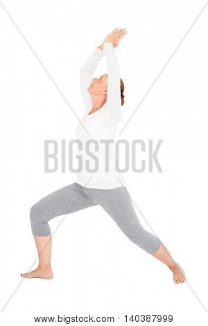Full length of active woman exercising on while background