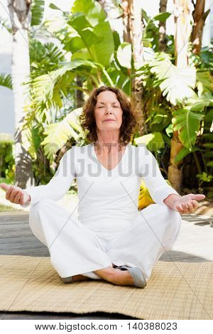 Full length of mature woman doing yoga