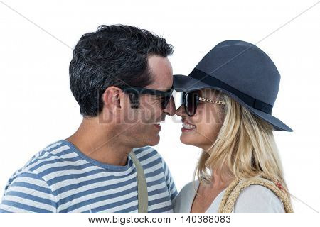 Close-up of cheerful couple against white background