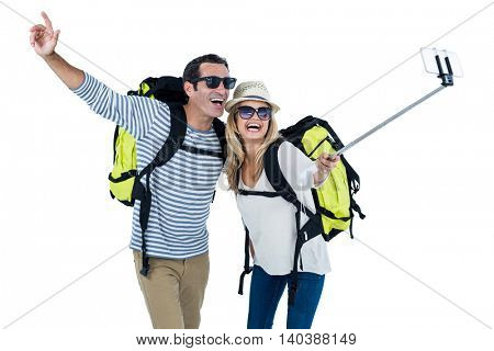 Happy mid adult couple taking selfie against white background