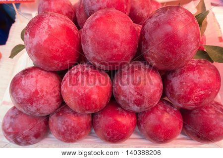 Fresh ripe red plums on market thai