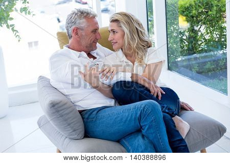 Romantic couple sitting face to face at home