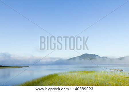 morning mist in a lake mountains clouds