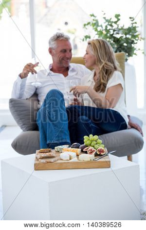 Food on table with smiling couple in background