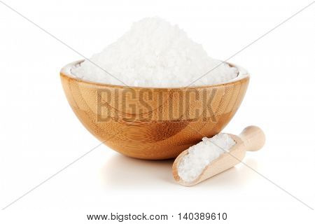 Cooking salt in a bamboo bowl, isolated on white background