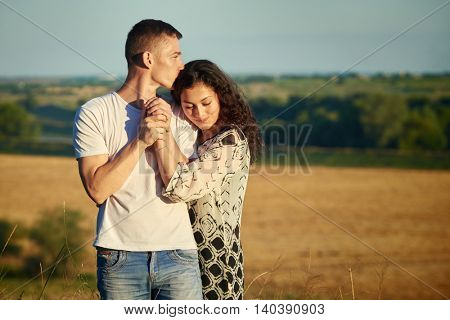 young couple portrait on country outdoor, love and tenderness concept, summer season