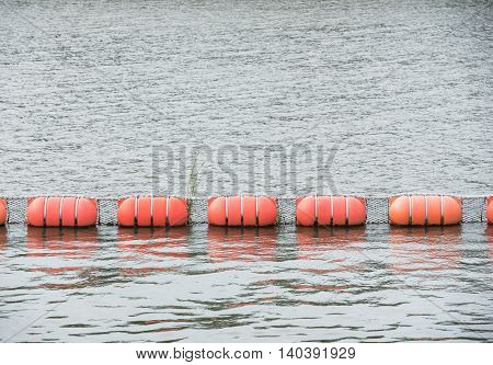 Buoys placed in a line on the surface