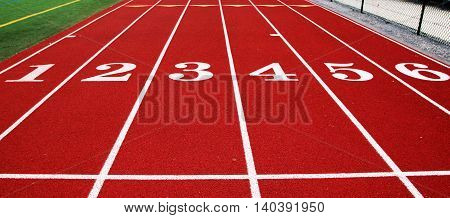6 lane track ready for athletes to compete on.