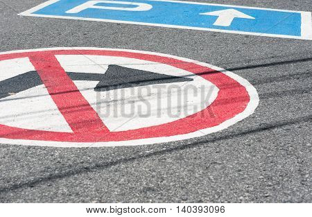 Marks on the road/ do not turn right