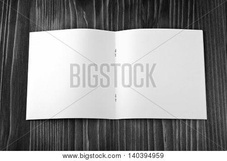 Blank catalog brochure book mock up. Empty opened magazine on wooden background