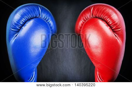 red and blue leather boxing gloves on a black background. Black background for your text