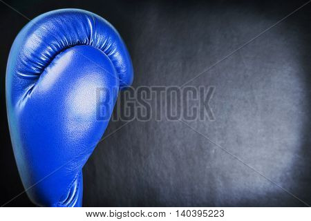 blue leather boxing gloves on a black background