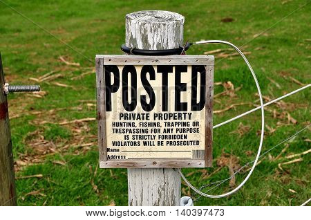 Ronks Pennsylvania - October 13 2015: A no trespassing sign posted on a wired fence on a local farm