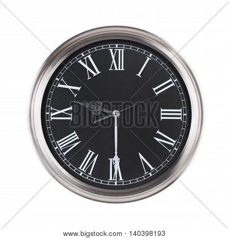 Round office clock shows half past nine