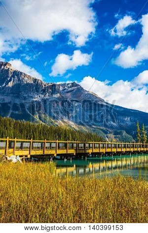 Yoho National Park, Canada. Wooden bridge over Emerald Lake. Camping and coniferous forest