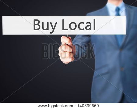 Buy Local - Business Man Showing Sign