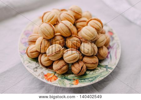 a beautiful dish with a large mound of cookies nuts with condensed milk