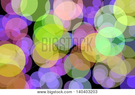 Blurred colored circles on a black background