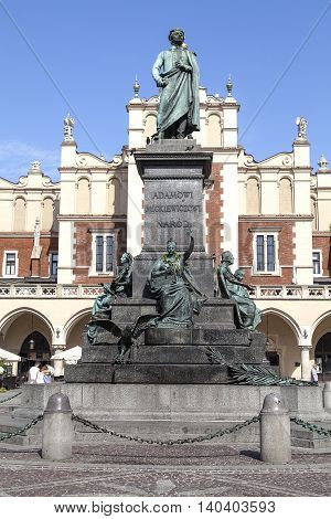 KRAKOW POLAND - JUNE 26 2016: Bronze statue of Adam Mickiewicz,  Main Market Square Old Town. He was the greatest Polish Romantic poet of the 19th century. The inscription on the pedestal reads:
