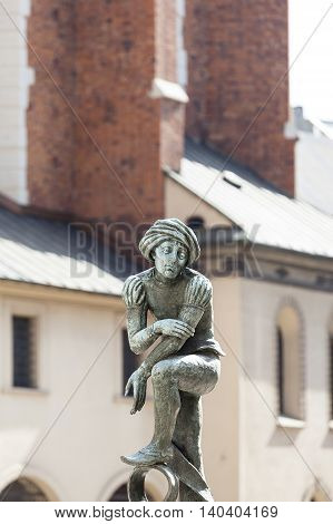 Figurine student a copy of the form from the altar of Veit Stoss fountain in the square of St. Mary's Krakow Poland