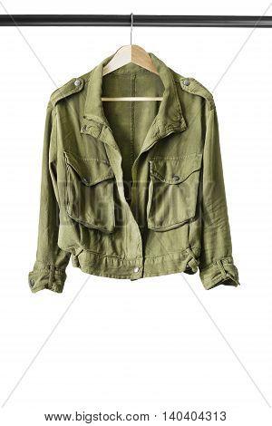 Khaki jacket on wooden clothes rack isolated over white