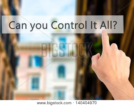 Can You Control It All ? - Hand Pressing A Button On Blurred Background Concept On Visual Screen.