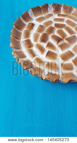 marshmallow candy tart on a turquoise wooden background