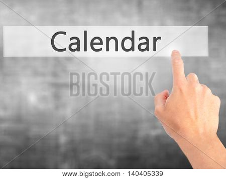 Calendar - Hand Pressing A Button On Blurred Background Concept On Visual Screen.