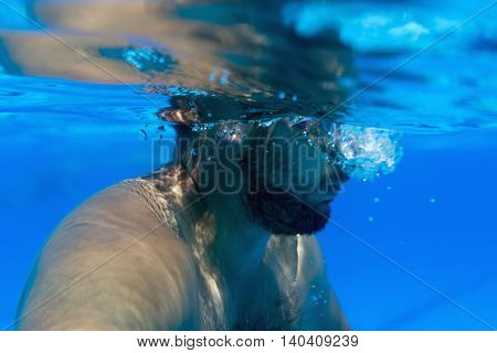 Man with Beard Half Underwater Young beard man with glasses Underwater