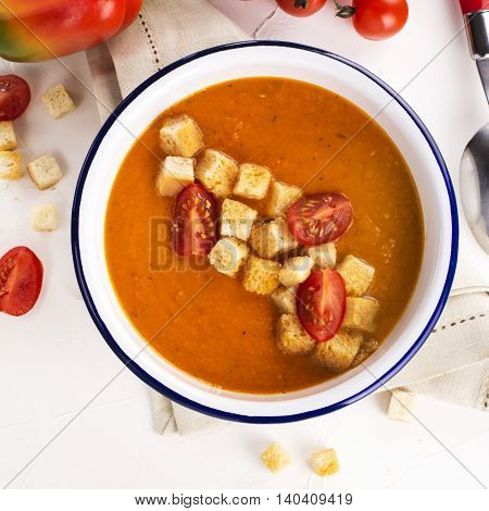 Tomato and carrot soup garnished with croutons