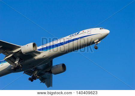 TOKYO, JAPAN - MAR. 28 2015: Boeing 777-300 landing to the Haneda International Airport in Tokyo, Japan.
