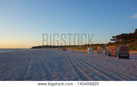 Beach with beach chairs at sunset on Hiddensee Island Germany
