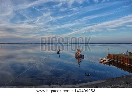HIDDENSEE GERMANY - JUNE 9 2016: Boats at sunset on Hiddensee island Germany