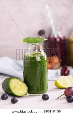 Homemade green smoothie with spinach, banana, lime and cucumber. Selective focus