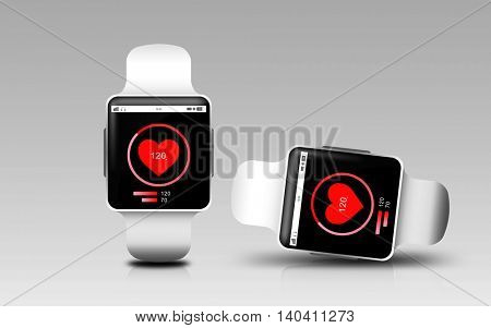 modern technology, health tracker, object, responsive design and media concept - smart watches with heart rate icon on screen over gray background