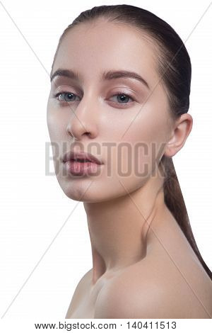 Portrait of beautiful young brunette woman with clean face. Beauty spa model girl with perfect fresh clean skin. Looking at camera and smiling. Youth and skin care concept.