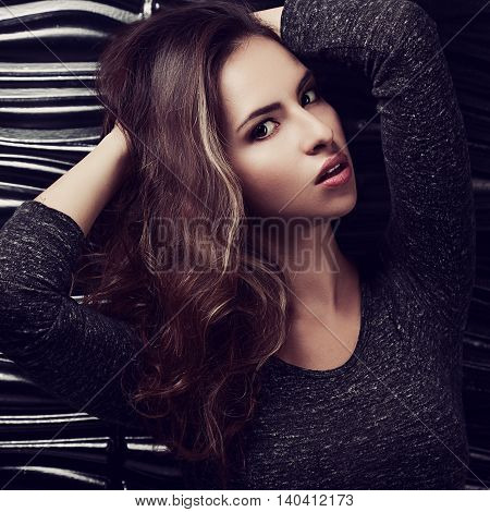 Sexy Young Hispanic Woman Posing On Black Background. Closeup Art Toned Portrait