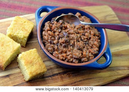 Chili Con Carne; with sliced squares of homemade cornbread.