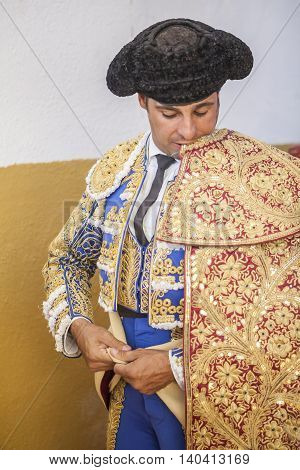 Sabiote Spain - September 9 2011: Spanish bullfighter Francisco Rivera putting itself the walk cape in the alley before going out to fight typical and very ancient tradition in Spain