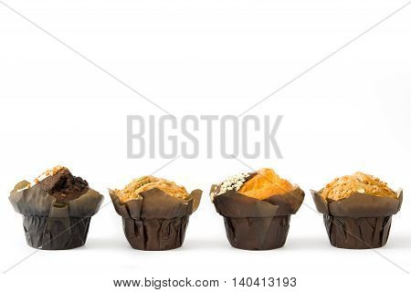 Delicious chocolate muffins isolated on white background