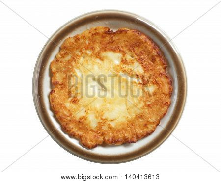 Homemade fried pancake in plate isolated on white background top view