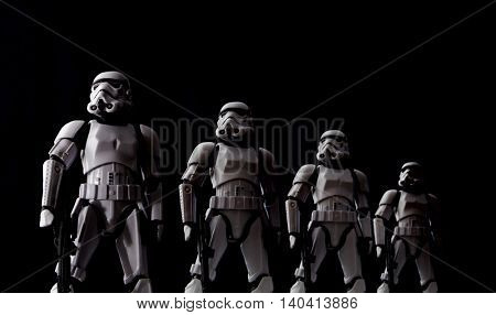 Star Wars Stormtroopers lined up with dramatic lighting - Hasbro Black Series 6 inch action figures.