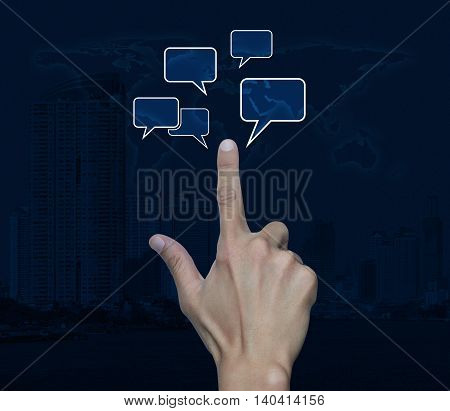 Hand point to chat sign and speech bubbles over map and city tower Social network concept Elements of this image furnished by NASA