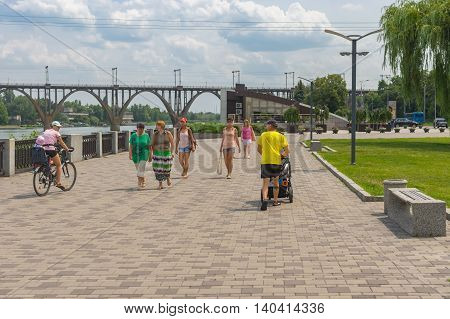 DNEPROPETROVSK UKRAINE - JULY, 10 2016: People walk on the Dnepr river embankment at summer weekend at Dnepropetrovsk Ukraine - July 10 2016