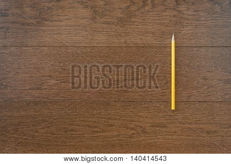 Yellow Pencil On Wooden Background