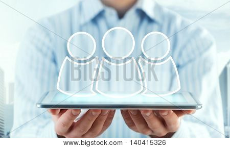 Hands of businessman holding tablet pc and teamwork concept on screen