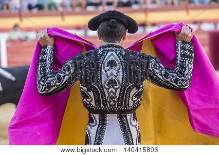 Sabiote Spain - August 23 2014: The Spanish Bullfighter bullfighting with the crutch in the Bullring of Sabiote Spain