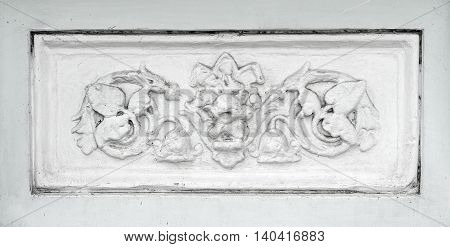 A pieces of ancient fretwork on the buildings
